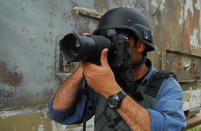 A photographer mid-shoot - stock photography equipment