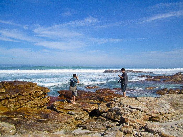 Shooting a stock photo session at coastal rocks