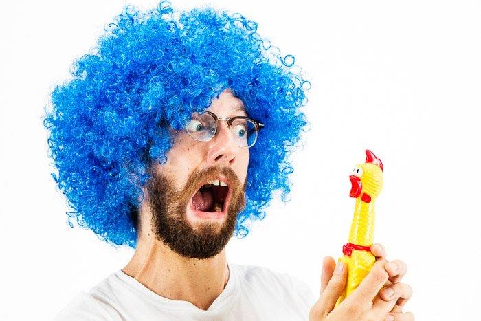 A humourous high key portrait of a clown