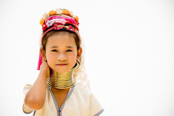 A high key portrait of a Thai girl in traditional clothing