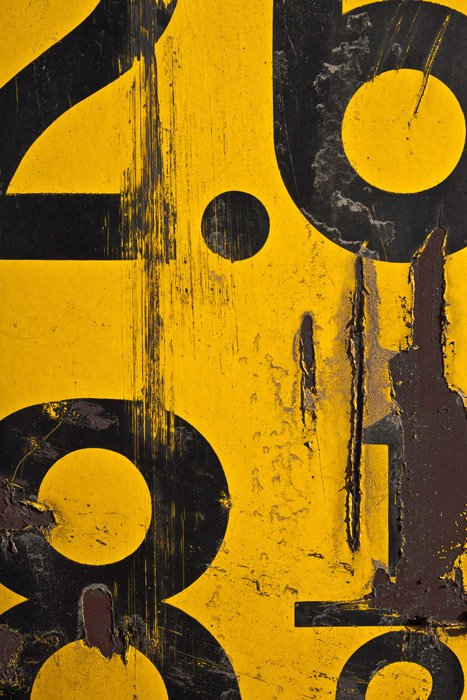 Close up of a yellow and black industrial sign
