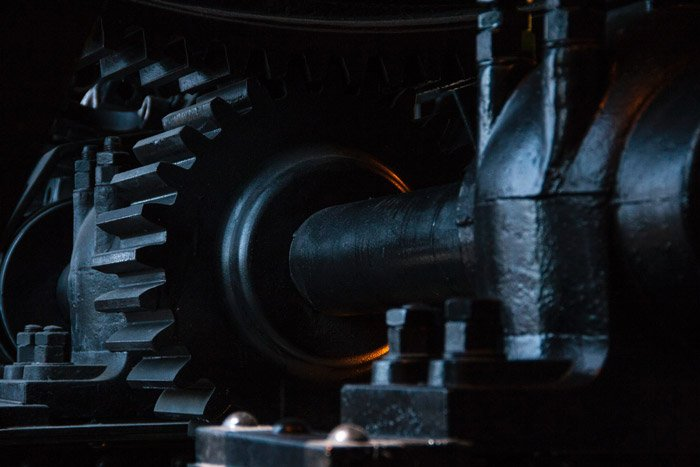 Close up shot of industrial machinery in low light