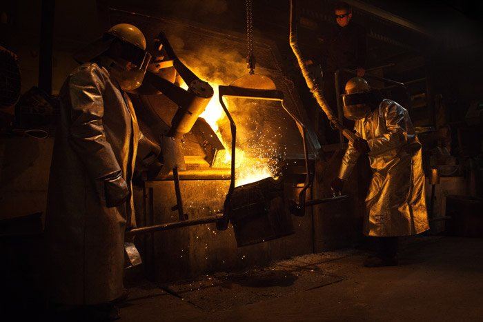 Industrial workers operating machinery