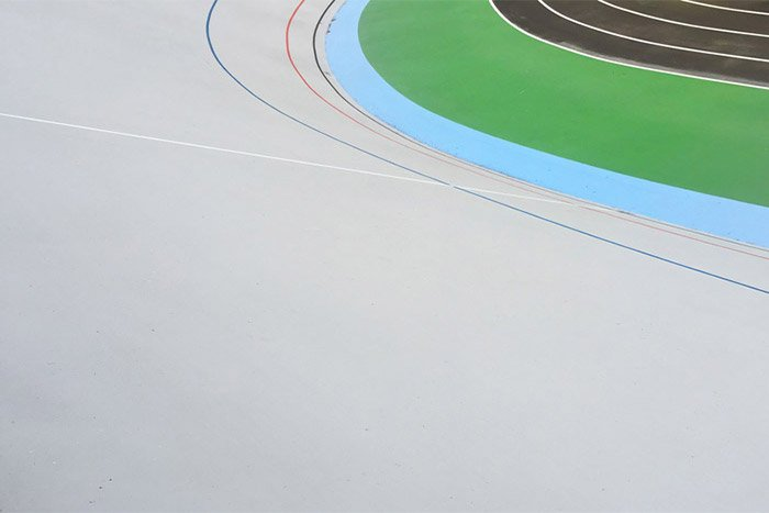 A minimalist abstract photo of a sports track