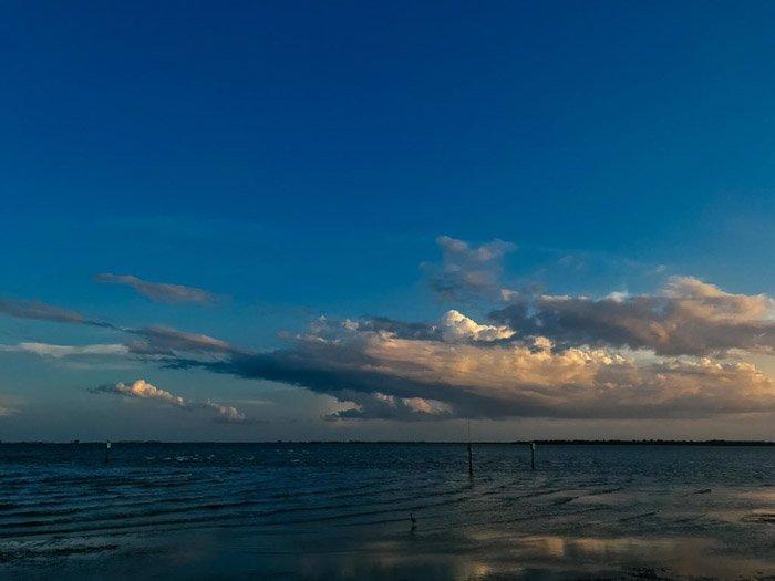 A dark shot of cloud over a seascape