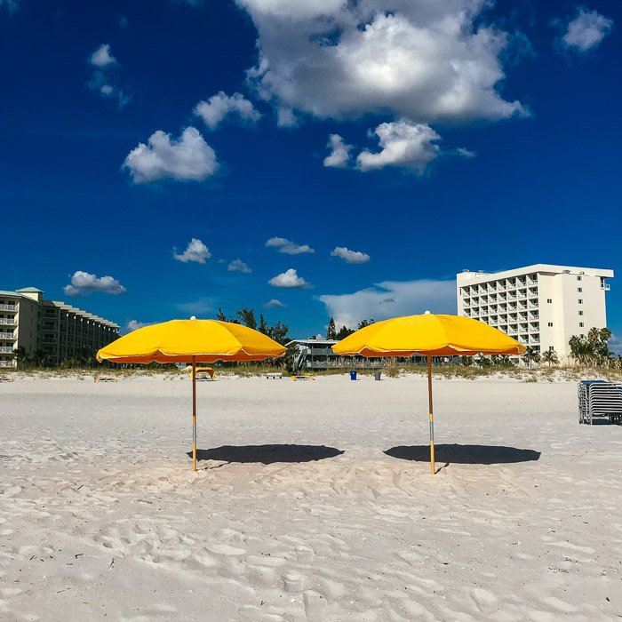 A stunning hdr iphone photo of yellow parasols on the beach