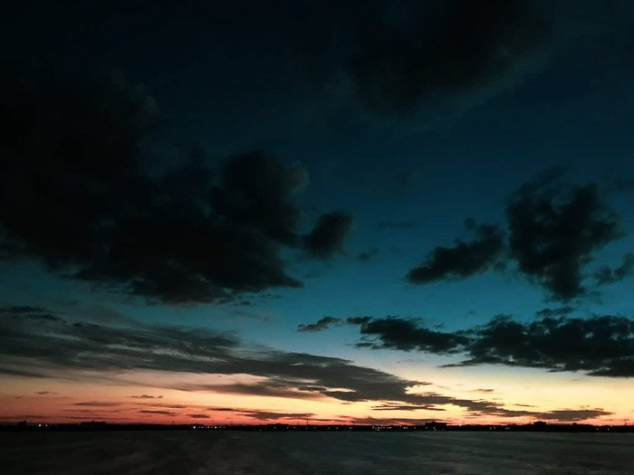 Incredible iphone night photography of a cloudy sky taken at blue hour