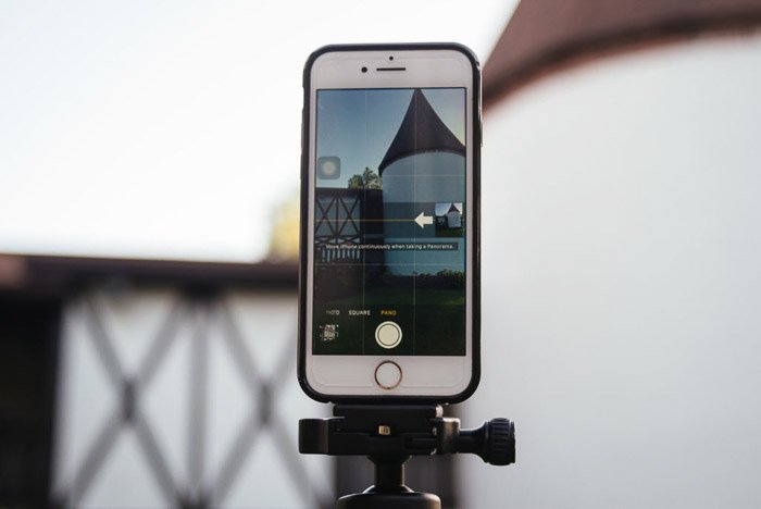 A phone mounted on a tripod for taking sharper iPhone panoramas
