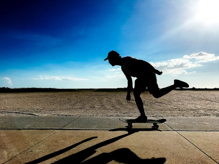 The silhouette of a skateboarder in action taken using iphone photo bursts
