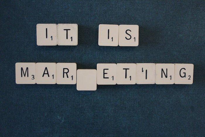 Scrabble letter spelling 'It is marketing'