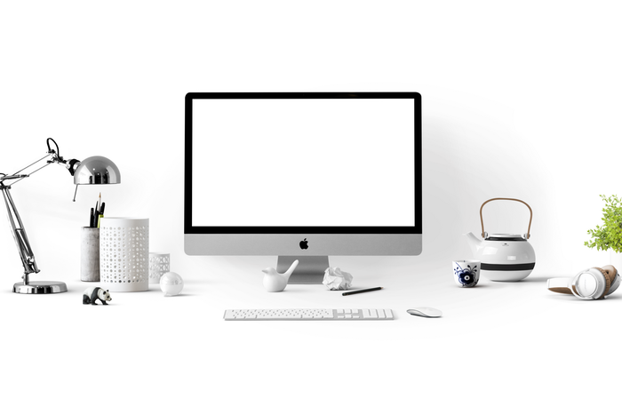 A pristine white office setup for photography marketing