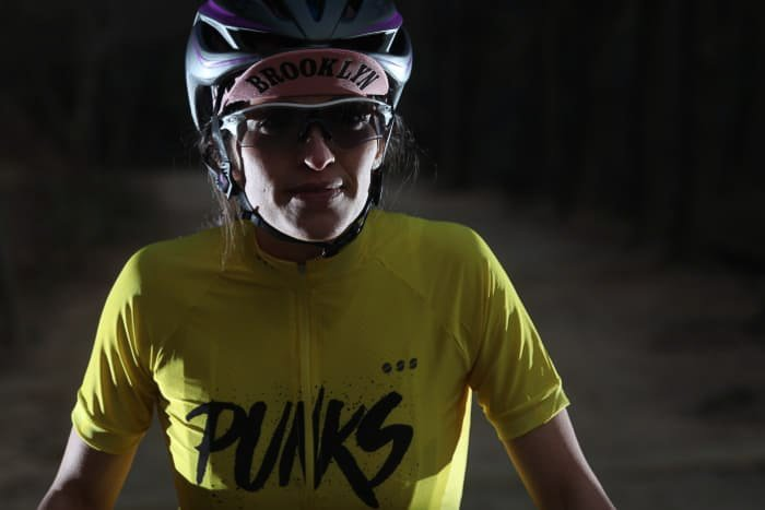 A portrait of a female athlete in low light