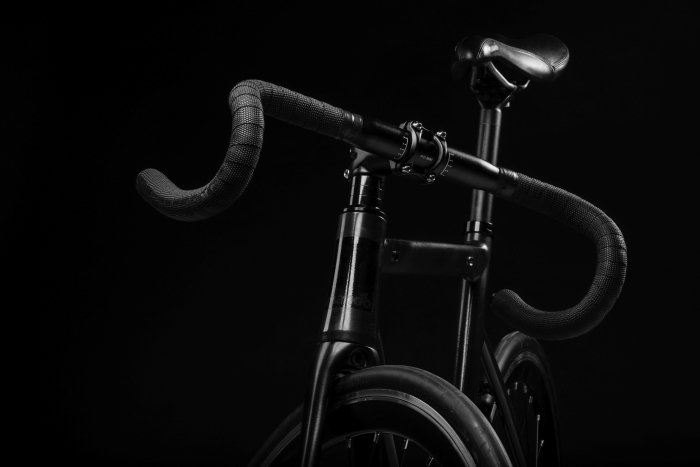 Black bicycle on a black background
