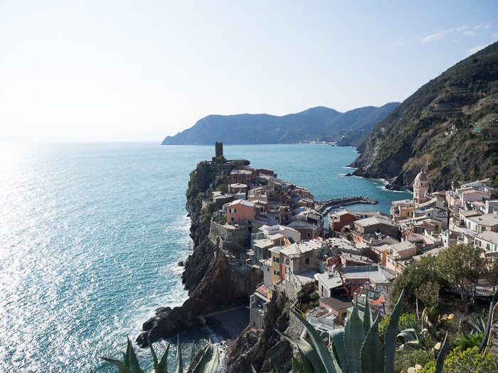 A summer landscape shot of an Italian coastal town demonstrating classic loss of contrast
