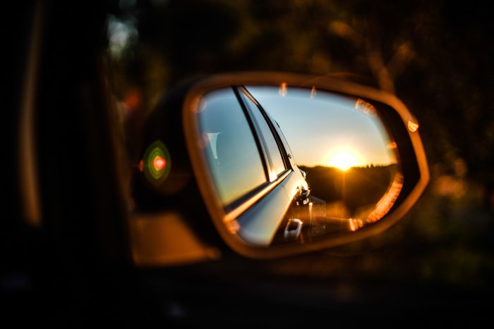 A car reflected in its own side mirror