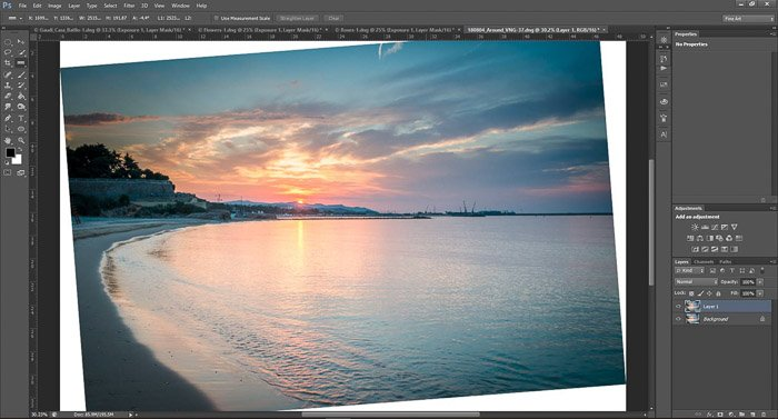 a screenshot showing how to rotate and straighten image in Photoshop