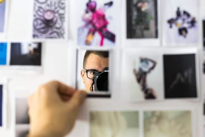 A photographer making a moodboard for a project