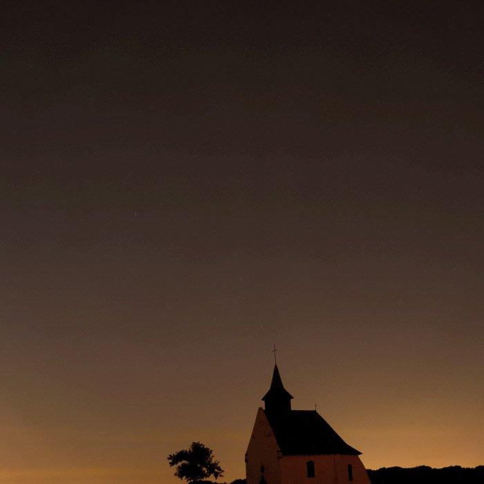 A night sky image over a church