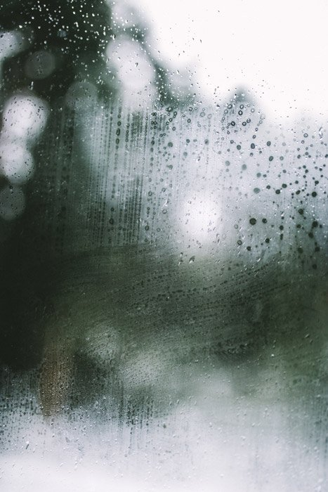 An abstract pattern on a rainy window - abstract landscape photography
