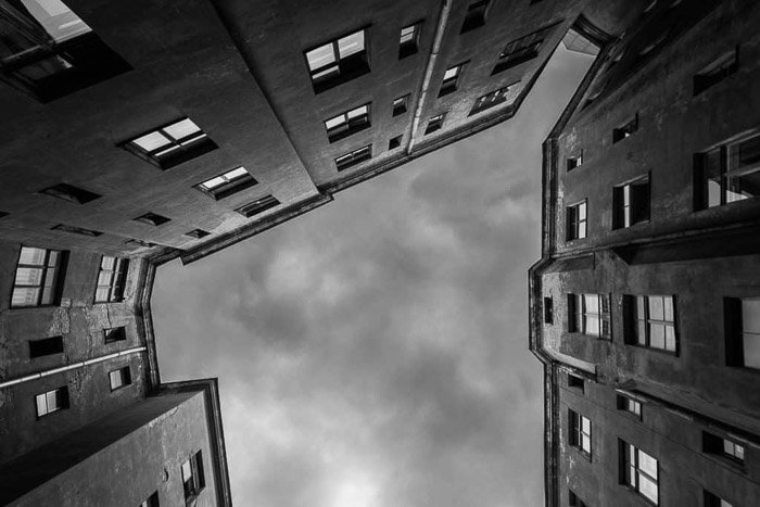 a black and white architecture photography shot of a buildings courtyard