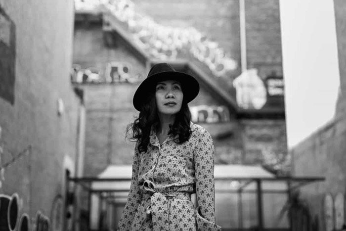 A black and white portrait of a woman in New York, NYC
