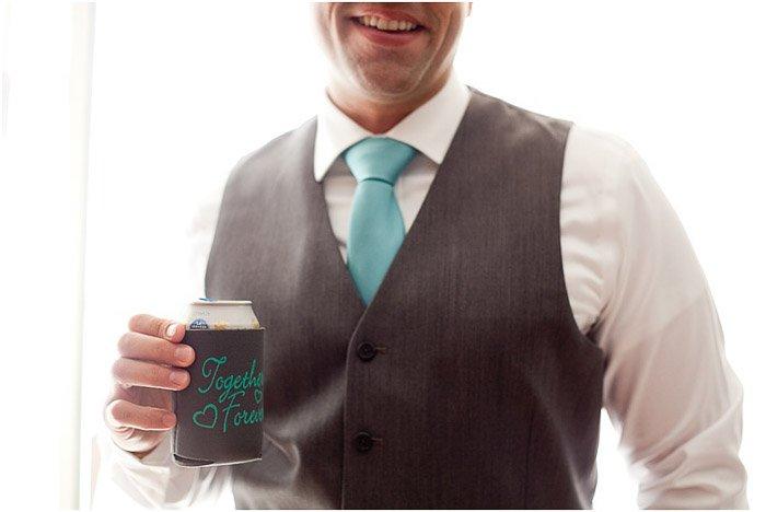 Casual wedding portrait of a groomsman posing outdoors at a destination wedding
