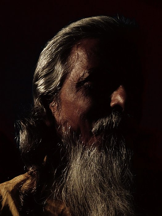 Atmospheric portrait of a male model shot with chiaroscuro lighting