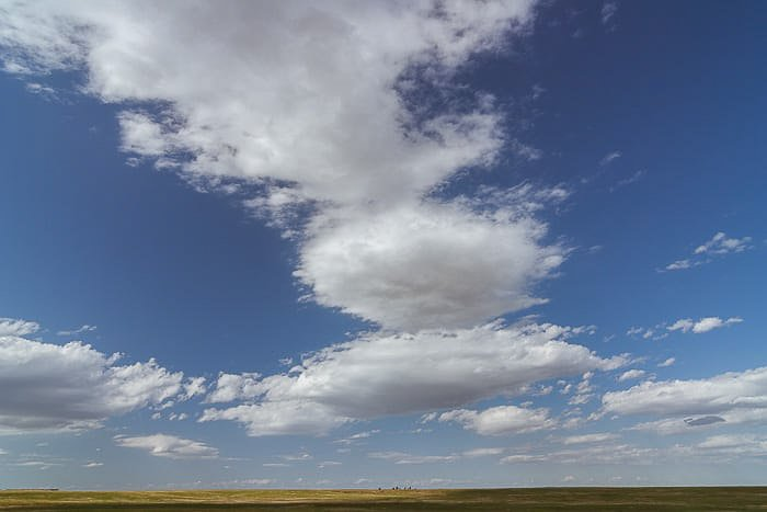 Cloudy skies over an American landscape