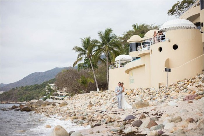 Beautiful wedding portrait of the couple embracing on a tropical beach