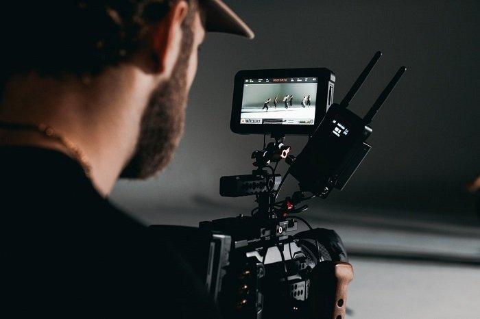 A man shooting a photography documentary