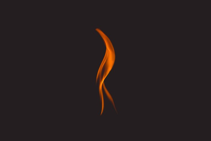 A single flame against a dark background - fire photography tips