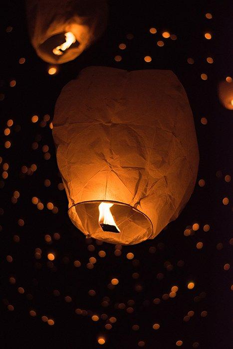 Lanterns ascending during a Lantern Festiva - fire photography ideas