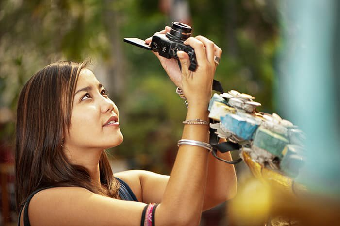 A flash photography portrait of a young female photographer