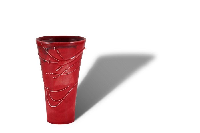 A product photography shot of a red vase with a strong shadow