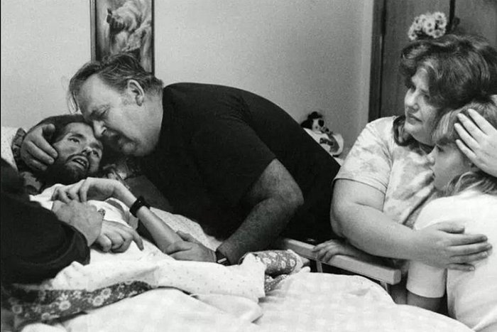 Family with David Kirby, famous photos by Therese Frare