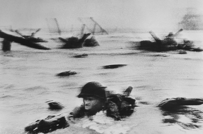 Robert Capa famous photos of D-day, Normandy. Omaha Beach. The first wave of American troops lands at dawn.