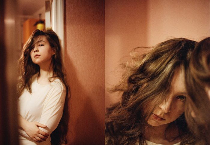 A diptych portrait of a brunette female model reflected in a mirror