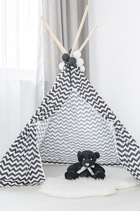 Modern interior with tipi, faux fur rug and teddy bear for newborn photography props