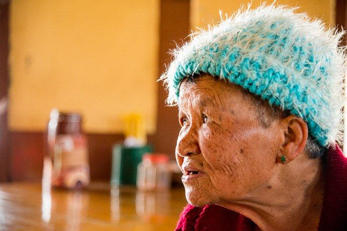 A portrait of an elderly thai woman shot using a rim light