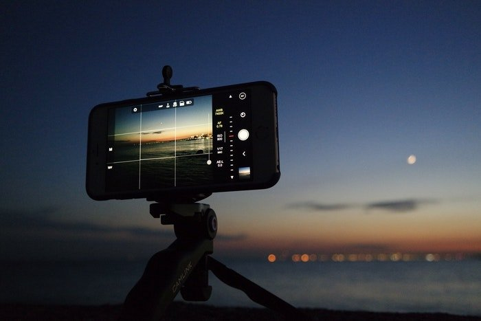An iPhone on a tripod taking a night time photo