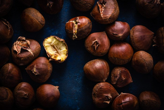 Stock photo example of chestnuts against a blue background