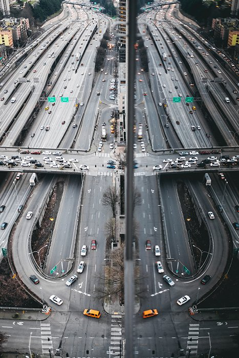 Aerial photo of a sprawling highway reflected in a building