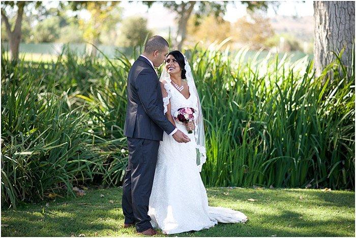 Destination wedding photo of the newlywed couple posing outdoors