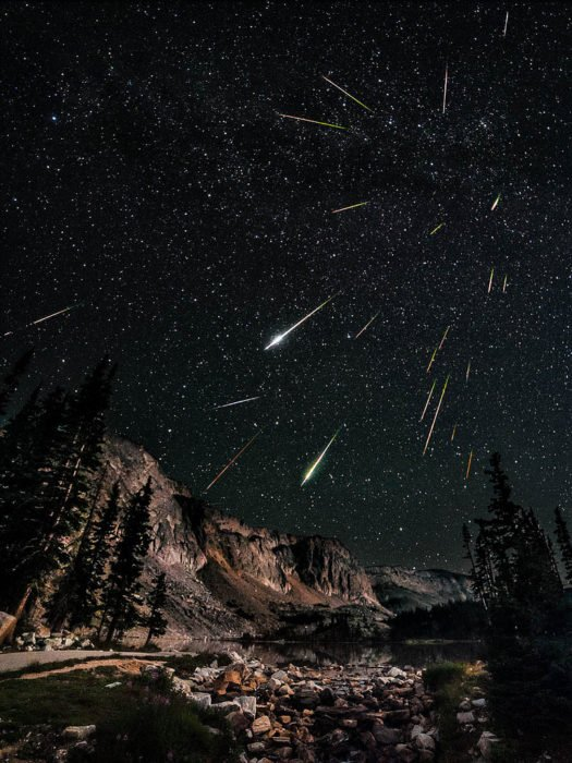 A nice nocturnal landscape showing many meteors coming towards the photograph, adding a 3D feeling to the image