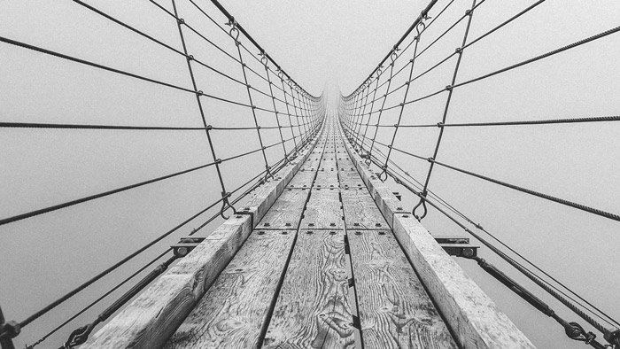 A black and white photograph of a bridge which demonstrates using the principle of art and design in photography