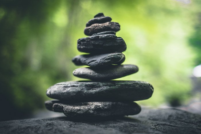 A pile of rocks outdoors, demonstrating unity in photography - principles of art and design