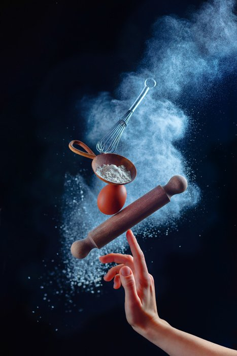 Amazing still life shot using flying kitchen utensils and flour clouds - creative still life photography