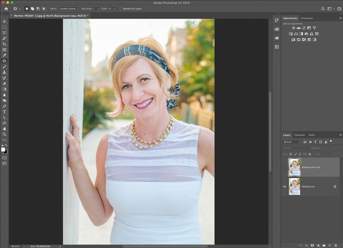 A screenshot showing how to use the Photoshop warp tool for editing portrait photography