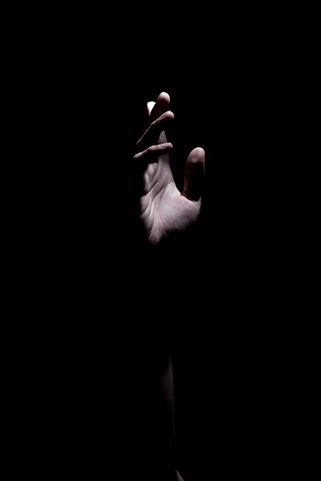 Atmospheric photo of a hand in low light - abstract photos of the body