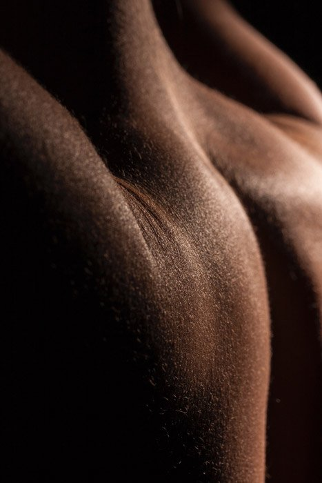 Close up abstract body photography using shadows and light